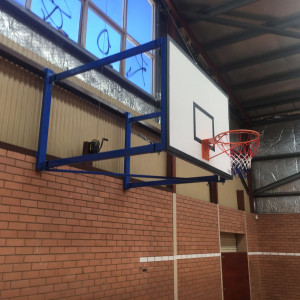 Wall-mounted side swing basketball goals for WA Rockingham Police & Citizens Youth Club